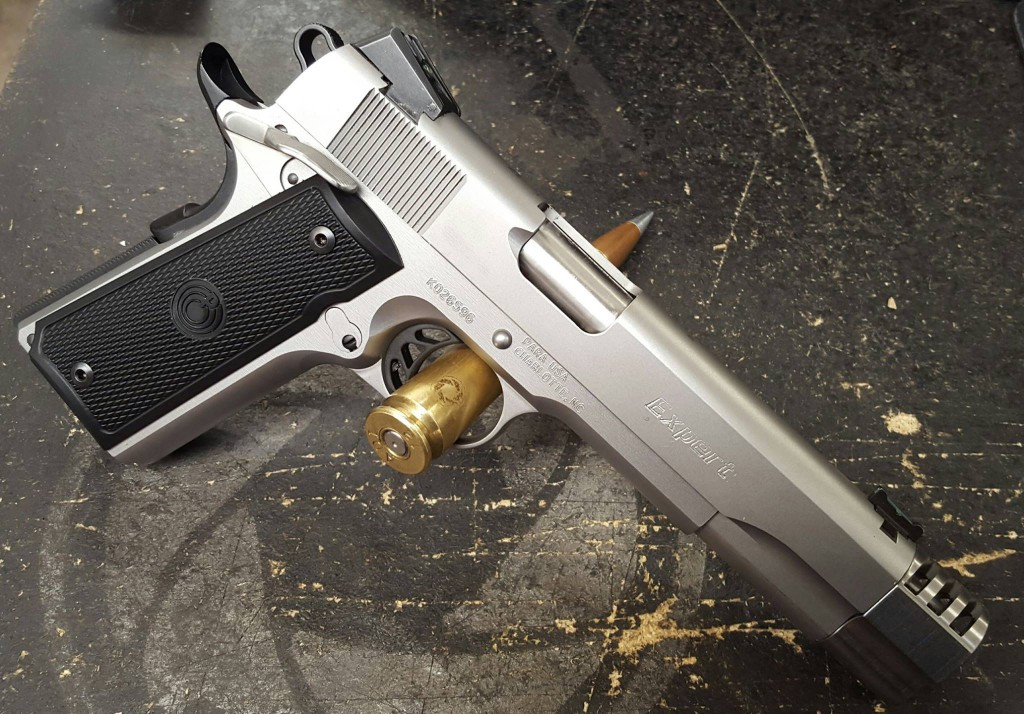 Rapid target acquisition made easier with bushing compensator, new sights and a full trigger job on this 45acp.