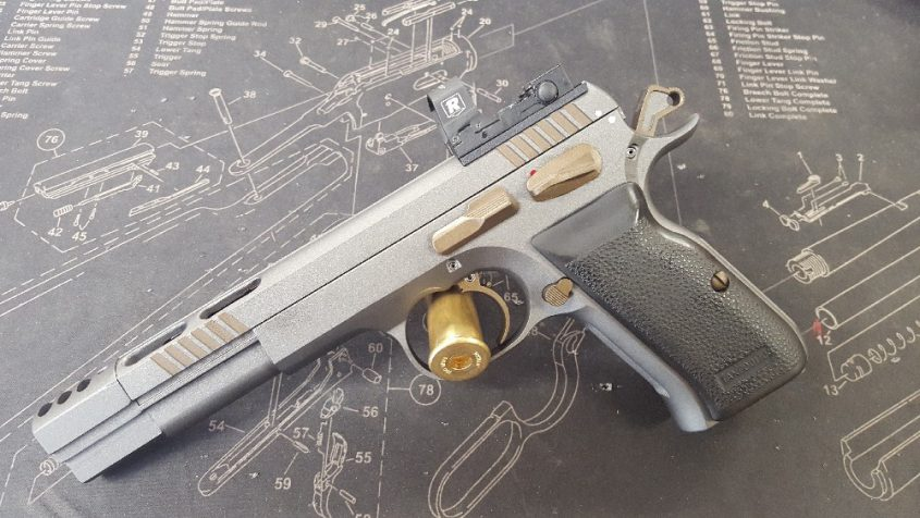 This Tanfoglio XL4in 38 super was reworked into a custom IPSC handgun with worked hammer, trigger, custom ICE compensator and Cerakote.